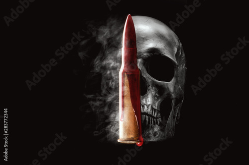 Stampa su Tela Human skull, bullet, blood and smoke on black background