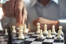 Competition And Challenge Concept, Two Businesspeople Playing Chess Board.