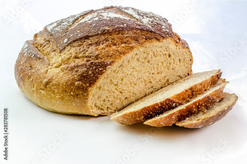 Tuinposter Brood Dark rye bread with three slices on a white isolated background.