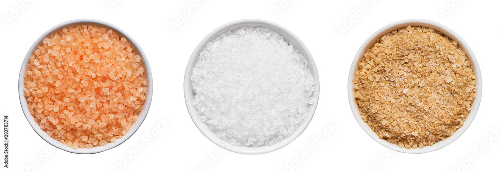 Fototapeta SPA concept. Set of bath salt in bowl isolated over white background with clipping path. Top view