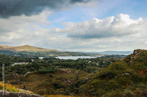 Landscape view of a bay in a cloudy day Wallpaper Mural