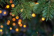Christmas tree close-up with colorful lights on a background. Shallow depth of field.