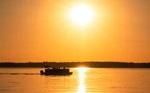 Pontoon Boat At Sunset