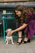 Dog And Girl In Street Cafe. B...