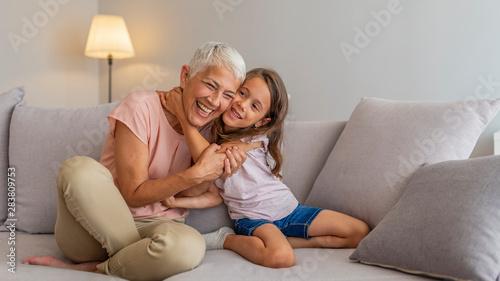 Obraz na plátně  Grandmother and granddaughter hug