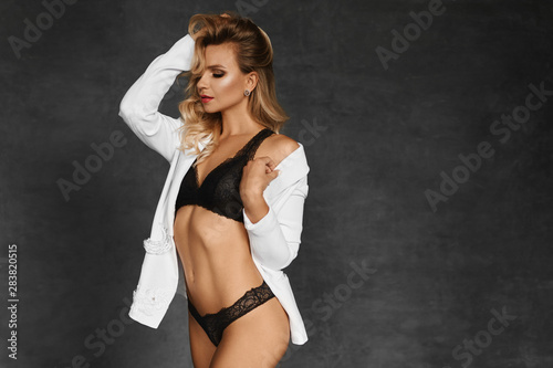 Fototapeta  Tender blonde with perfect body wearing black lace underwear and white shirt
