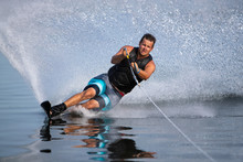 A Slalom Waterskier Carving A ...