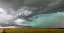 Dramatic Sky And Clouds With Hail And Green Sky