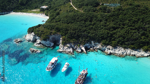 Poster de jardin Europe Méditérranéenne Aerial drone photo of tropical paradise turquoise beach of Voutoumi with sail boats docked in island of Anti paxos, Ionian, Greece