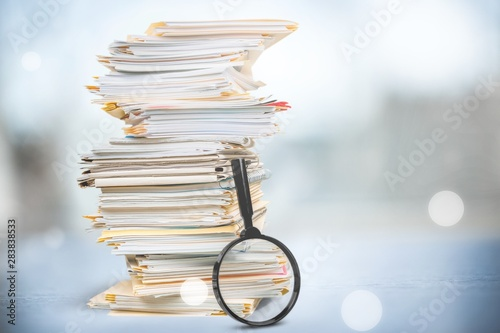 Obraz File folders with documents and magnifying glass on background - fototapety do salonu