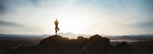 Woman Doing Yoga On The Mountain