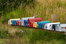Colorful Mailboxes Are Seen With A Grass Background.