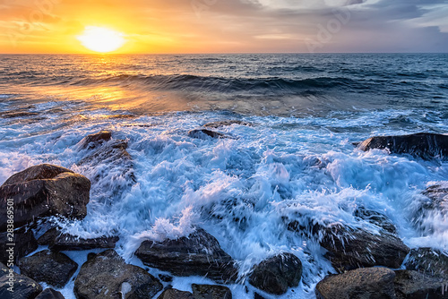 Obraz na plátně  The stunning seascape with the colorful sunrise sky at the rocky coastline of th