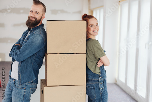 Fototapeta  Proud pleased young couple moving into a new home