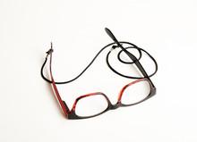 Stylish Red Eyeglasses With Black Cord On White Background