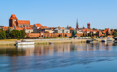Panoramic view of Torun city and Wisla (Vistula) river in sunny day. Poland, summer 2019