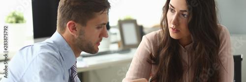 Fototapeta Businessman and businesswoman confer in office obraz