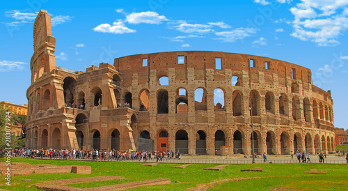 Fotografiet Rome, Italy - April 7, 2016: Tourists visiting the Colosseum on APRIL 7, 2016 in Rome, Italy