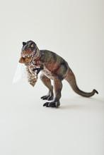 Tyrannosaurus Rex Toy. Plastic Dinosaur Toy Isolated On Light Background