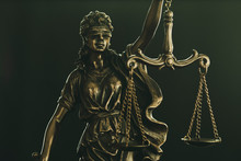 Figure Of Justice Holding Up The Scales Of Law
