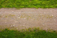 Horizontal Strip Of Green Grass And Dirt Road, Blurred Focus