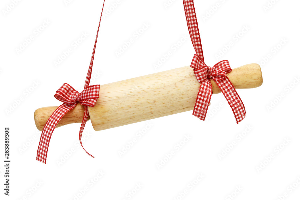 Obraz rolling pin hangs in front of white background fototapeta, plakat