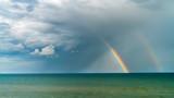 Fototapeta Tęcza - rainbow over the blue sea, seascape as background