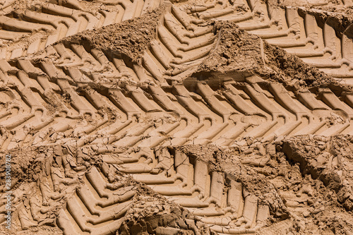 Truck work machine wheel tracks in the sand, in a real estate development area