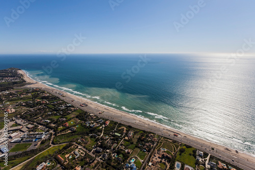 Obraz na plátně Aerial view of large pacific ocean view homes and Zuma Beach in Malibu California