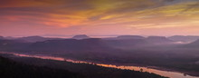 Top View Above Mekong River Around With Mountains, Forest, Soft Mist With Red Sky Background, Sunrise At Cha Na Dai Cliff, Pha Taem National Park, Ubon Ratchathani, Thailand.