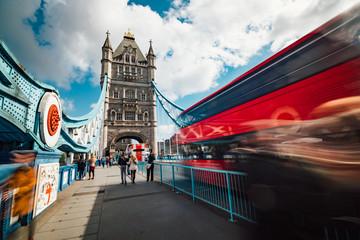Fototapeta na wymiar Motion blurred pedestrians and traffic at Tower Bridge in London