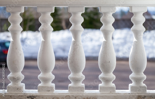 White balusters in a row, classic handrails Wallpaper Mural