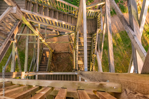 View from the top into the inward of a wooden lookout tower.