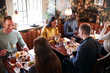 canvas print picture - Group Of People Eating In Restaurant Of Busy Traditional English Pub
