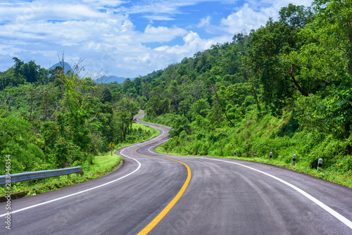 Keuken foto achterwand Lavendel Beautiful asphalt road and forest