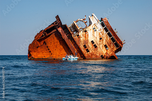 Photo Stands Ship old wreck ship in the sea