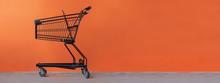 Shopping Cart On An Orange Bac...