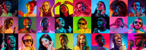 Fototapeta Beautiful male and female portrait on multicolored neon light backgroud. Smiling, surprised, screaming, dance. Human emotions, facial expression. Creative collage made of different photos of 14 models obraz
