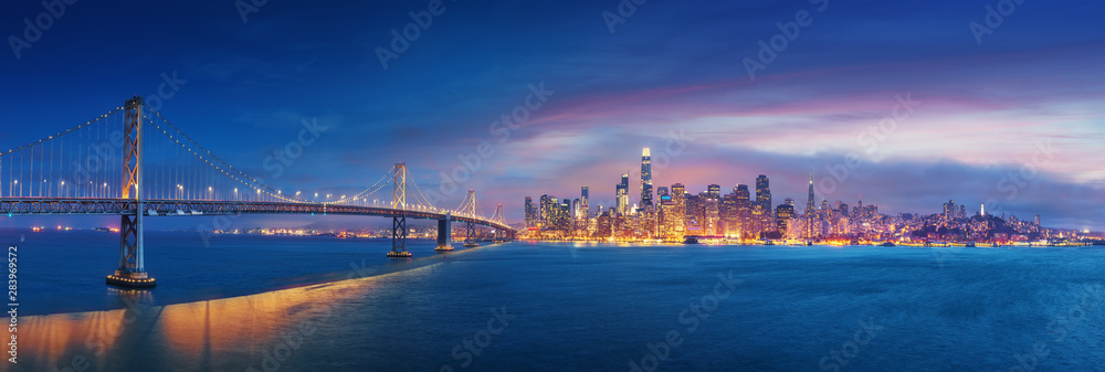 Fototapeta San Francisco Bay Bridge and San Francisco downtown in wide panorama photo
