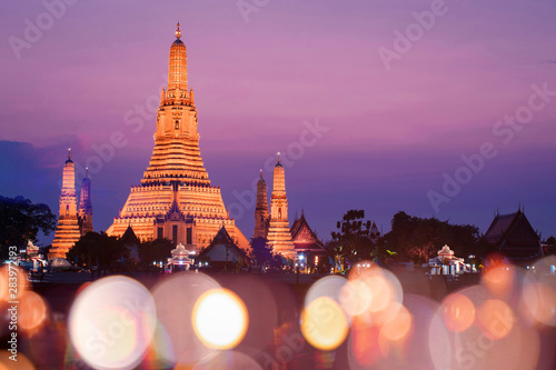 Recess Fitting Bangkok Wat Arun temple with sunset and blur bokeh at foreground during sunset.