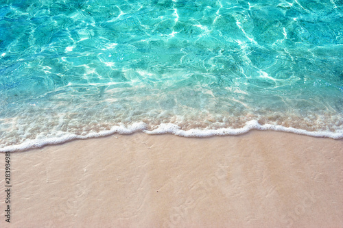 fototapeta na drzwi i meble Soft blue ocean wave or clear sea on clean sandy beach summer concept