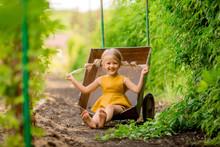 Happy Little Blonde Girl In Th...
