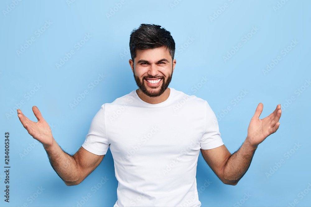 Fototapeta happy successful man rejoicing at big sales on clothes, happiness, unexpected good fortune, victory of his favourite team. studio shot