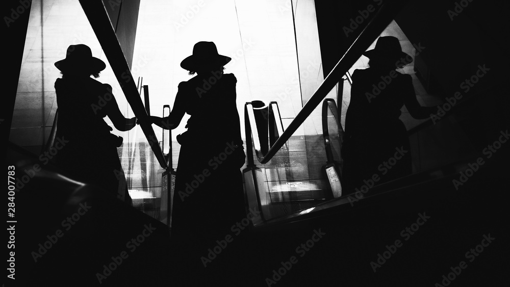 Fototapeta Woman with hat. Conceptual image. Black and white image.