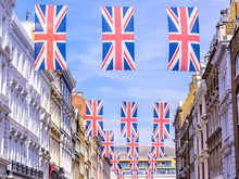Many Union Flags Union Jacks Flying Above A Street In London.