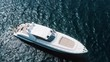 aerial view of a luxury white yacht on the sea
