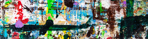 Abstract art with splashes of multicolor paint; as a fun; creative & inspirational background texture - in long panorama / banner.