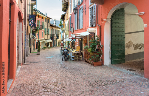 Photo sur Toile Europe Centrale Historic center with typical bars, restaurants and shops in Luino, is a small touristic town on the eastern shore of Lake Maggiore, Italy