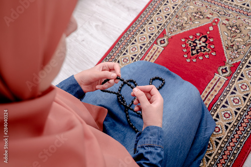 Fotografija  Muslim woman prayer, muslim girl open hands praying with rug