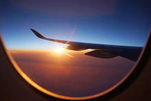 Sunlight Through Airplane Window From Wing During Sunrise